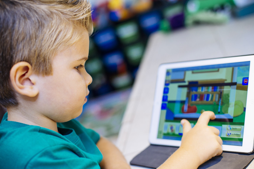 Kids play educational games on iPads